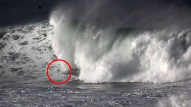 Garrett McNamara is swallowed by the wave's massive lip.