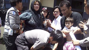 Crackdown ... Indonesian police round up Afghan immigrants.