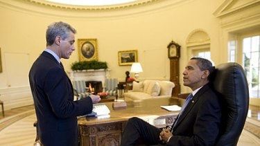Down to business: Barack Obama talks with White House Chief of Staff Rahm Emanuel.