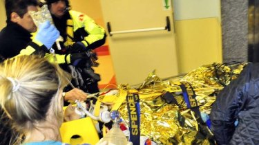 Injured ... rescue workers carry away Formula One driver Robert Kubica.