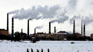 China is investing in wind and solar power, but factories such as these in the north-east Heilongjiang province caused a 13 per cent increase in  carbon emissions last year.