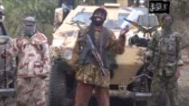 Fanatic: Boko Haram leader Abubakar Shekau (centre).