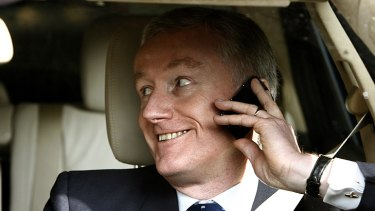 Stripped ... Fred Goodwin leaves the RBS's annual general meeting in a good mood in 2008.