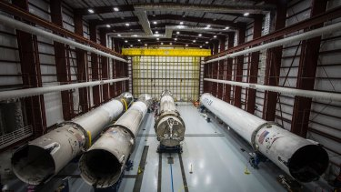 Recovered Falcon rocket boosters in a hangar at the Kennedy Space Center.