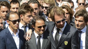 Formula One drivers Jean-Eric Vergne (second from right) and Felipe Massa (second from left), friends and relatives gather around the coffin of late Marussia F1 driver Jules Bianchi during the funeral ceremony at the Sainte-Reparate Cathedral in Nice, France.