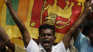 A Sri Lankan man waves his national flag in central Colombo.