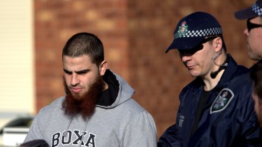 Hassan El Sabsabi, 23, is led away from the Seabrook property.
