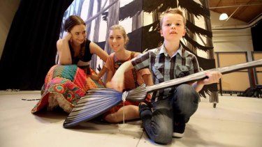 Seven-year-old Ben Hogan, who is on the autism spectrum, with (from left to right) soprano Cristina Russo and mezzo-soprano Emma Muir-Smith during a Victorian Opera rehearsal.