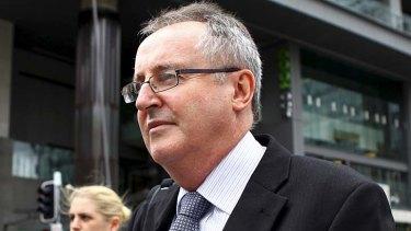 Wivenhoe Dam engineer Robert Ayre leaves the Queensland Flood Inquiry in Brisbane.
