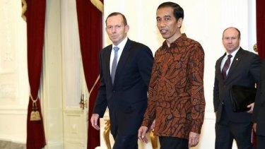 Indonesian President Joko Widodo (right) meets Australian Prime Minister Tony Abbott prior to a meeting at the Presidential Palace in Jakarta.