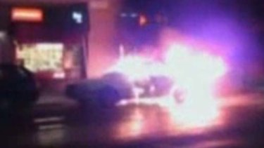 Explosion ... this video grab shows a car on fire in  Stockholm.