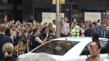 Princess Mary waves to the crowd outside the Ole Lynggaard store in Sydney.