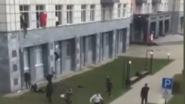 A gunman has opened fire at a university in Russia, with students forced to jump out of windows to safety.
