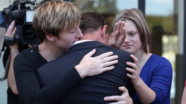 Same-sex couples console one another in Canberra.