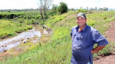 Darren Jahnke shows the revegetated stream bank beside his flood affected Lockyer Vally farm.
