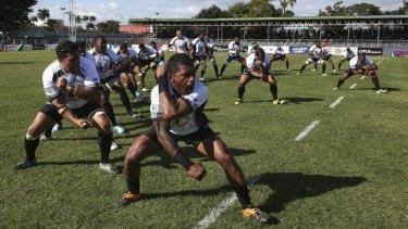 War dance: The Fijian national team lay down a challenge ahead of kick-off.