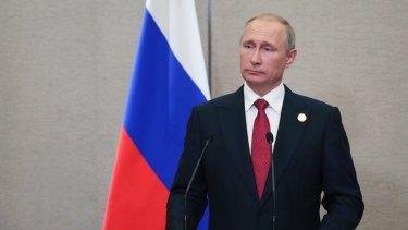 Russian President Vladimir Putin warned North Korea would not abandon its weapons program.