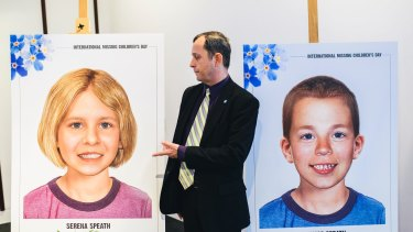 Harry Speath with aged-progessed images of his missing children, Serena and Thomas.