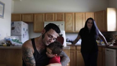 Reformed character ... Bryon Widner hugs his four-year-old son, Tyrson.