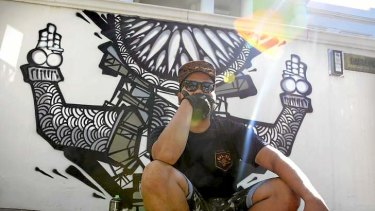 Trademark: Indonesian street artist Darbotz with some of his work in Toorak.