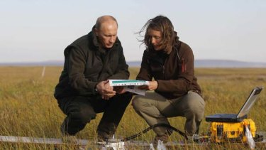 Field trip ... Vladimir Putin listens to a member of the scientific expedition in the Russian Arctic.