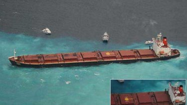 The Chinese-registered bulk coal carrier Shen Neng 1 aground 70 kilometres east of Great Keppel Island. INSET: A close-up of the ship shows oil leaking from it's port side.