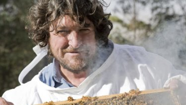 """The buzz... Denis Anderson with honey bees in a clip from """"Honeybee Blues"""" by award-winning director Stefan Moore."""