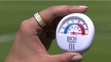 Temperature rising: A thermometer shows nearly 50 degrees at surface level during the opening match between China and Canada.