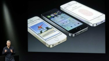 Tim Cook, CEO of Apple, speaks on stage during the introduction of the new iPhone 5s.