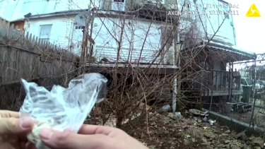 Another video released last last month by Baltimore's public defender appeared to show an officer planting a small bag of capsules in a trash-strewn yard.