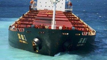 The Chinese bulk coal carrier Shen Neng 1 aground on Douglas Shoals.