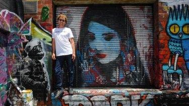 Dean Sunshine withy a piece of street art in a Brunswick laneway.