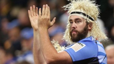 Fan favourite: A Force supporter wears a Nick Cummins wig.