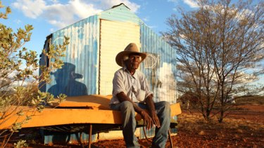 Banjo Morton sits outside his tin shed at Honeymoon Bore.