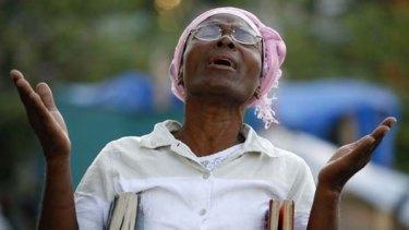 Divine help ... a woman sings at a church service in Port-au-Prince.