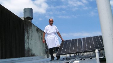 Restaurateur Philippe Pinson believes his 15 solar panels - fitted at a cost of $12,000 - should save about $200 each quarter.