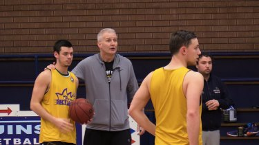 Holding court: Kings coach Andrew Gaze with guard Jason Cadee at training on Thursday.