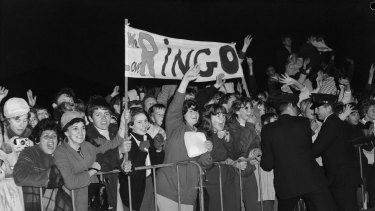 Fans await the arrival of Ringo Starr of The Beatles at Sydney Airport in June 1964.