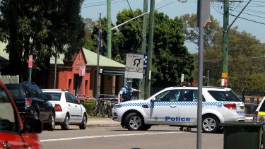 The man died after allegedly threatening officers at Quakers Hill police station.