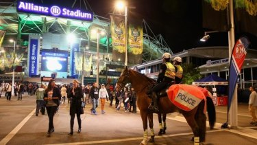 Increased surveillance: Mounted Police monitor spectators arriving at the 1st NRL Semi Final match at Allianz Stadium.