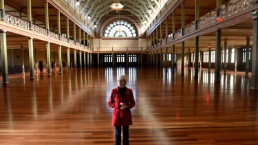 Greta Bird from the Carlton Residents Association inspects the Royal Exhibition Building, which will receive $20 million in funding.