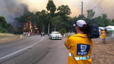 Firefighters battle the bushfires on Sunday.