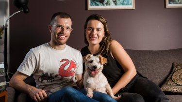 Turner couple David Kearns and Alisa Draskovic are the proud new owners of Lochie, the dog recently rescued by RSPCA ACT.