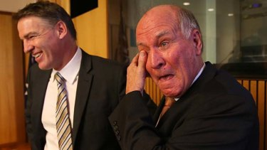 Calling it quits: an emotional Tony Windsor stands with Rob Oakeshott after announcing he will not recontest the next election.