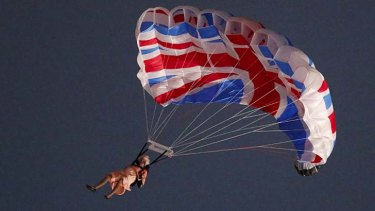 A performer playing the role of Britain's Queen Elizabeth parachuted from a helicopter during the opening ceremony.