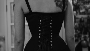 Tara Moss wearing a corset she  made herself after doing a specialised course. The asymmetry in her back is evident.