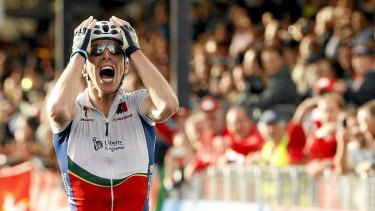 Rui Costa celebrates as he becomes the first Portuguese rider to wear the rainbow jersey.