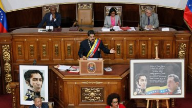 Nicolas Maduro  addresses Constitutional Assembly members during a special session at National Assembly building in Caracas on Thursday.