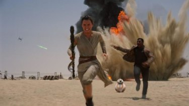 Daisey Ridley as Rey, left, and John Boyega as Finn in <i>Star Wars: The Force Awakens</i>.