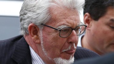 Rolf Harris arrives at Westminster Magistrates Court, to face sex offence charges, in London in September 2013.